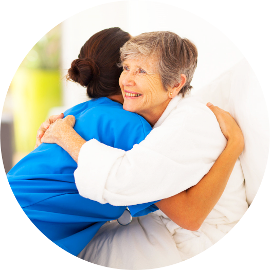 nurse and elderly woman hugging each other