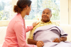 nurse and elderly man talking